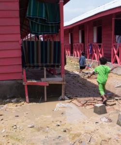 Rohingya children run around Kuala Langsa camp in Aceh, Indonesia.